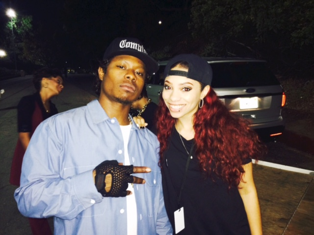 Jason Mitchell, left, who plays Eazy-E in Straight Outta Compton, with Eazy's daughter E.B. on set.